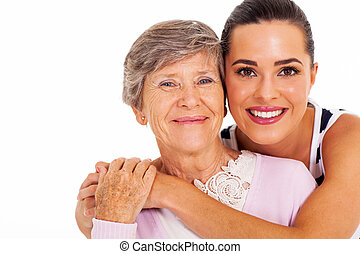 senior mother and adult daughter - happy senior mother and...