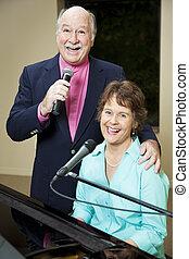 Happy Senior Singers - Senior couple enjoys performing...