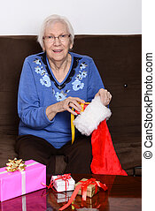 senior stuffing christmas stocking