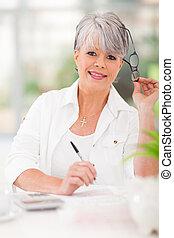 senior woman doing home finances