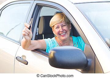 happy senior woman driver