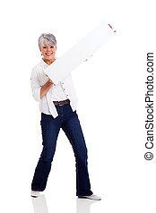 senior woman holding white board