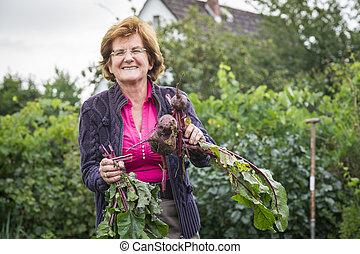 happy senior woman in garden