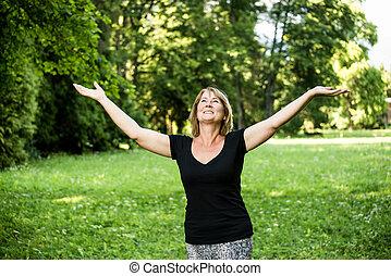 Happy senior woman in nature