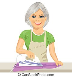 Happy senior woman ironing clothes. Housework. Isolated on...