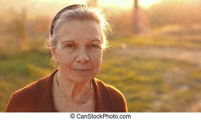 Happy senior woman on sunset