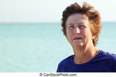 Happy Senior woman on vacation