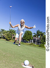 Happy Senior Woman Playing Golf & Putting