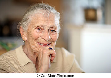 Happy senior woman portrait, close-up, shallow DOF.