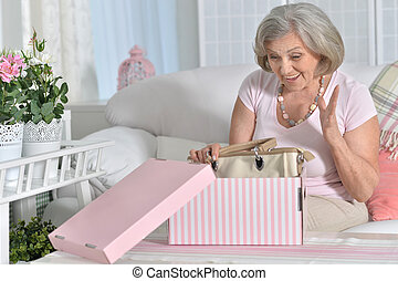 happy Senior woman portrait  on giftbox