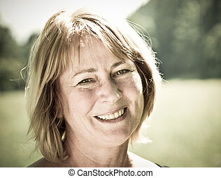 Happy senior woman portrait - outdoor