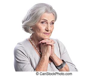 happy senior woman posing on white background
