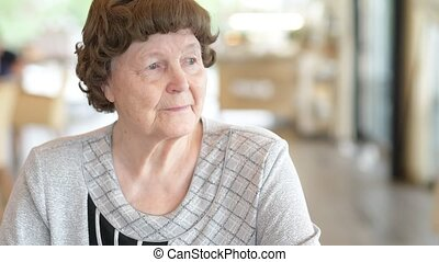 Happy Senior Woman Relaxing At The Coffee Shop