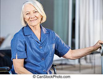 Happy Senior Woman Sitting On Wheelchair