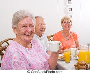 happy senior woman - a happy senior woman drinking coffee...