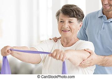 Happy senior woman stretching