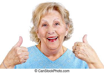 Happy senior woman thumps up