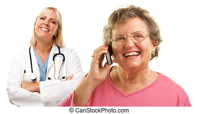 Happy Senior Woman Using Cell Phone with Female Doctor Behind