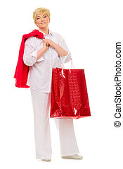 Happy senior woman with bag