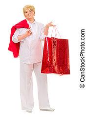 Happy senior woman with bag
