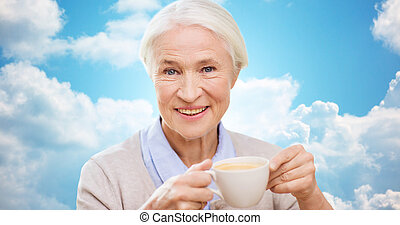 happy senior woman with cup of coffee
