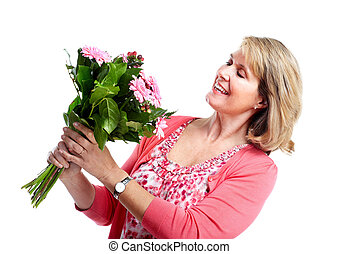 Happy senior woman with flowers.