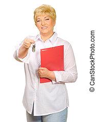 Happy senior woman with keys