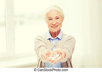 happy senior woman with medicine at home