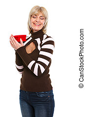 Happy senior woman with present box