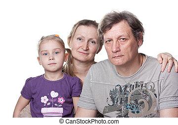 Happy seniors couple with grandchild