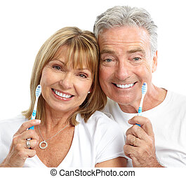 seniors couple - Happy seniors couple with toothbrushes. ...