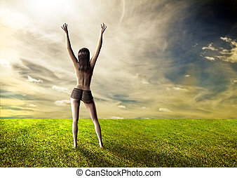 Happy sexy girl topless on field