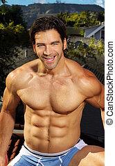 Happy shirtless muscular man
