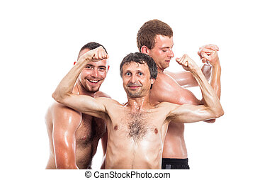 Happy shirtless sportsmen posing