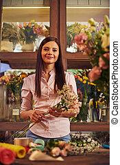 Happy shop assistant