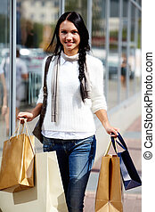 Happy shopaholic - Image of happy female with paperbags...