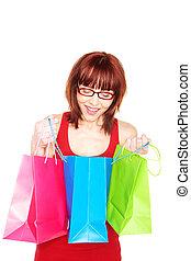 Happy Shopper Looking In Carrier Bag