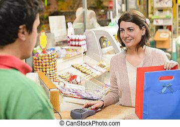 Happy Shopper - Shopping in a textile market