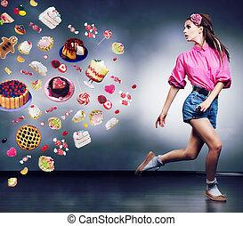 Happy shopper woman running in studio. Advertising concept