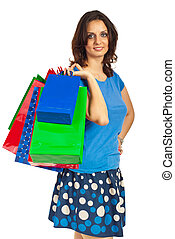 Happy shopper woman with bags