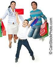 Happy shopping family jumping
