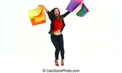 bdf6592efa74b Female shopper holding multicolored shopping bags on white background in  studio. Let's go shopping concept. Happy shopping woman excited and cheerful  ...
