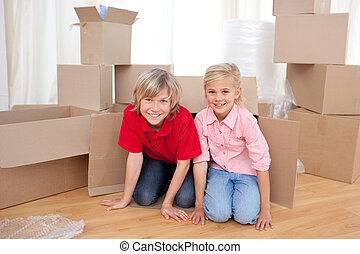 Happy sibling having fun while moving house