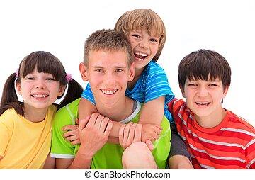 Happy Siblings - A portrait of happy siblings in colorful T-...