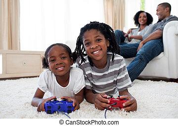 Happy siblings playing video game