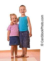 Happy siblings posing for the camera