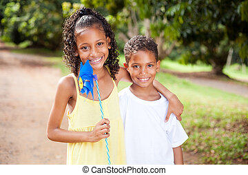sister and brother with pinwheel