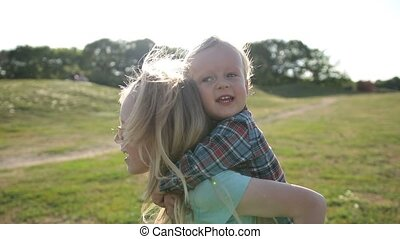 Happy sister carrying cute little brother on back