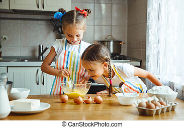 happy sisters children girls bake cookies, knead dough, play...
