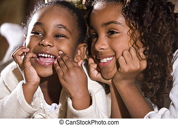 Happy sisters - Two happy faces of African American sisters...